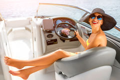 Woman driving yacht Royalty Free Stock Photography