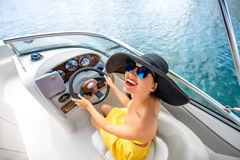 Woman driving yacht Royalty Free Stock Image