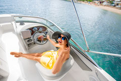 Woman driving yacht Stock Photography