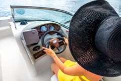 Woman driving yacht Royalty Free Stock Images
