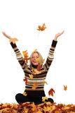 Woman drop autumn leaves in studio. Woman drop up autumn leaves in studio Royalty Free Stock Images