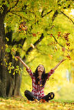 Woman drop leaves in autumn park. Woman drop up leaves in autumn park Royalty Free Stock Photography