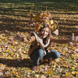 Woman drop leaves in autumn park Royalty Free Stock Images