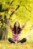 Woman drop up autumn leaves Royalty Free Stock Photography