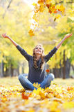 Woman drop up leaves Stock Image