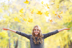 Woman drop up leaves Royalty Free Stock Image