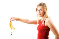 Woman droping banana skin Royalty Free Stock Image