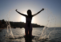 Woman droping water in the sea royalty free stock photos