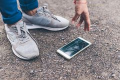 Free Woman Dropped Mobile Phone On The Ground And Smashed The Screen Royalty Free Stock Photography - 100178117