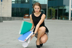 Woman dropped to the ground folders Stock Photos
