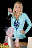Woman Dropping Cell Phone Blender Royalty Free Stock Photography