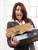 Woman dropping documents. Business woman dropping documents and screaming royalty free stock images