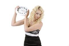 Woman dropping down clock Royalty Free Stock Photo