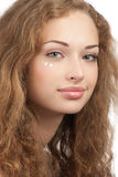 Woman with drops of moisturizer cream on her face Royalty Free Stock Photography