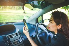 Woman driving astray. Woman drove astray in the forest. Looking for a solution But without internet signal from the phone stock photography