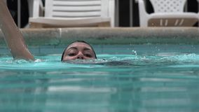Free Woman Drowning In Swimming Pool Royalty Free Stock Photo - 61631855