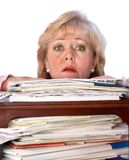 Woman drowning in paperwork. Mature woman buried by the paperwork Stock Images