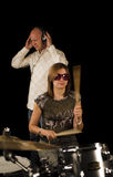 Woman drummer playing royalty free stock images