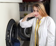 Woman in a dry cleaning with malodour Stock Image