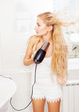 Woman dry hair Stock Photography