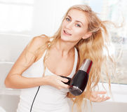 Woman dry hair Royalty Free Stock Photos