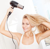 Woman dry hair hairdryer at bathroom Stock Photo