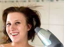 Woman with dryer. Woman drying hair in bathroom Stock Photography