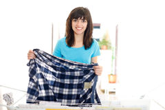 Woman drying clothes Stock Image