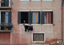 Woman is drying clothes outdoor in Venice, Italy Royalty Free Stock Images