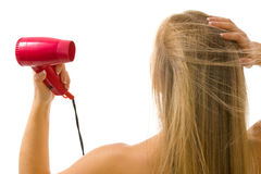 Woman drying hair Royalty Free Stock Images