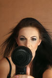 Woman drying hair Royalty Free Stock Photography