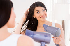 Woman drying hair. Royalty Free Stock Photo