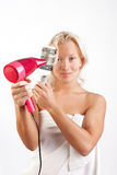 Woman drying her beautiful blond hair Royalty Free Stock Images