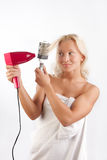Woman drying her blond hair Royalty Free Stock Images