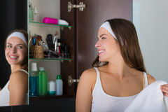 Woman drying her face with a towel Royalty Free Stock Photos