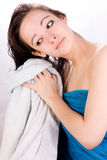 Woman is drying her hair. Young woman is drying her hair with a towel Stock Images