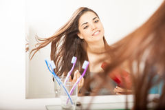 Woman drying her hair in a bathroom Royalty Free Stock Images