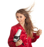 Woman drying her hair by dryer Stock Images
