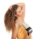 Woman drying her hair by dryer Stock Photo