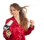 Woman drying her hair by dryer Stock Photos