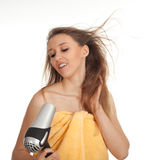 Woman drying her hair by dryer Royalty Free Stock Photos