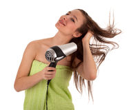 Woman drying her hair by dryer Royalty Free Stock Image