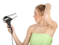 Woman drying her hair by dryer Royalty Free Stock Images