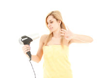 Woman drying her hair by dryer Royalty Free Stock Photo