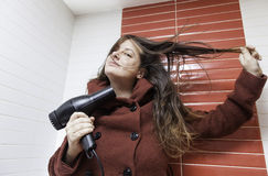 Woman drying her hair Stock Image