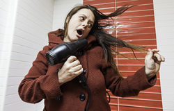 Woman drying her hair Stock Photography