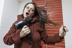 Woman drying her hair Royalty Free Stock Photography