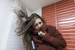 Woman drying her hair Royalty Free Stock Photo