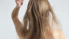 Woman drying her hair stock footage