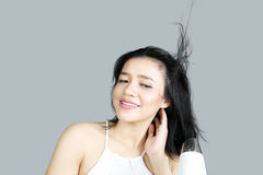 Woman drying her hair with a hair dryer. Portrait of young woman drying her hair with a hair dryer after bathing Stock Images
